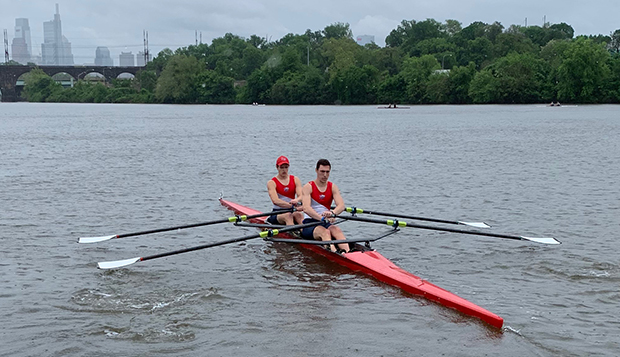 Liberty rising seniors Brad Weisman (left) and Ryan Krupansky row the Men's Double off the dock to the starting position. (Submitted photos) test test test test