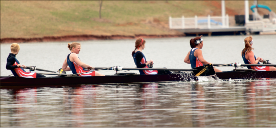 Crew now at Liberty — Rowers representing Liberty's newly formed crew team slice through Ivy Lake's waters in their first home regatta duel with William and Mary. Photo credit: Ruth Bibby