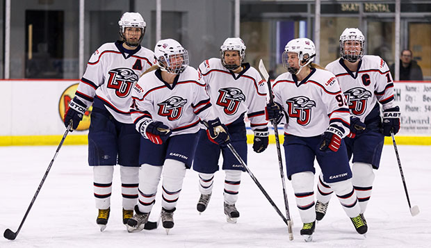Liberty's entire line celebrates a goal during a Feb. 7 game at the LaHaye Ice Center. The seventh-seeded Lady Flames finished third at the ACHA DI National Championships in Newark, Del.  test test test test