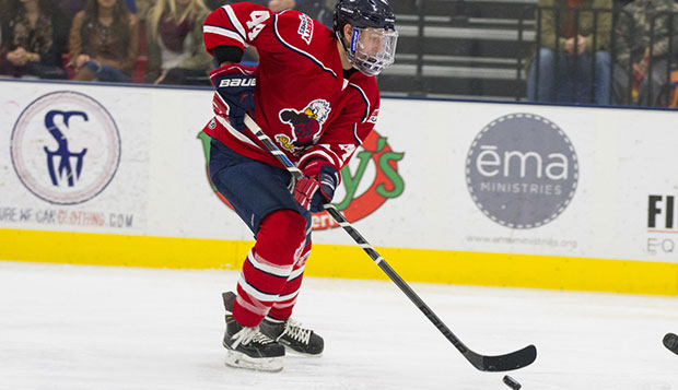 Liberty senior defenseman Cam Bakker scored the Flames' third goal on a power play midway through the third period, Friday night against West Virginia at the LaHaye Ice Center. test test test test