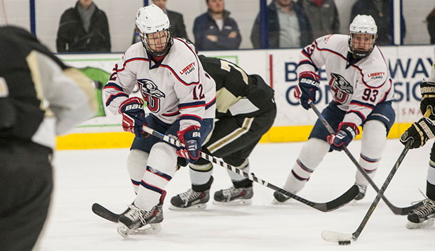 Liberty senior forwards Christian Garland (12) and Ryan Kerr (93) will play the last games of their ACHA DI careers this weekend at the LaHaye Ice Center. test test test test