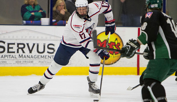 Liberty sophomore defenseman Grant Garvin battles for possession of the puck in the Flames' first game against Ohio, Jan. 23 in the LaHaye Ice Center.  test test test test