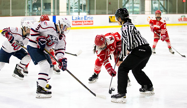 Liberty graduate forward and head captain Carrie Jickling takes a faceoff against Miami captain Izzy Smith during Sunday's final. (Photo by Leah Seavers)  test test test test