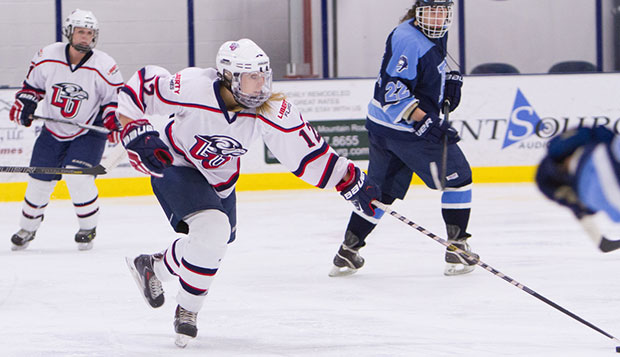Liberty senior defenseman Madison Fischer starts a counterattack against Rhode Island, Saturday night at the LaHaye Ice Center. test test test test