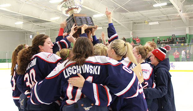 The Lady Flames hoist the ACHA Division I National Championships trophy after defeating Miami of Ohio, 4-1, Sunday afternoon at the York (Pa.) Ice Center. test test test test