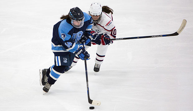 Liberty freshman Aly Morris (right) defends against Rhode Island's Monica Darby in Friday night's win at the LaHaye Ice Center.  test test test test