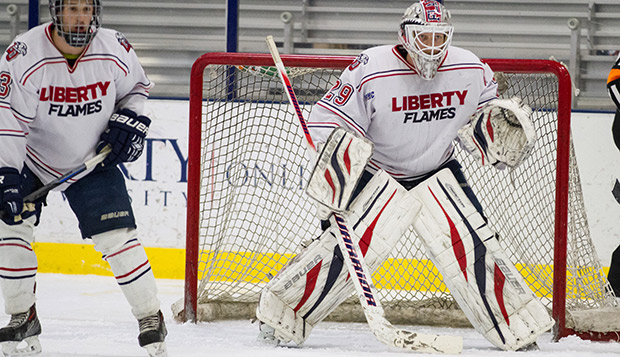 Senior goalie Blair Bennett, flanked by sophomore defenseman Roger Roulette, stood tall for the Flames throughout the 4-3 overtime loss to the Lakers. test test test test