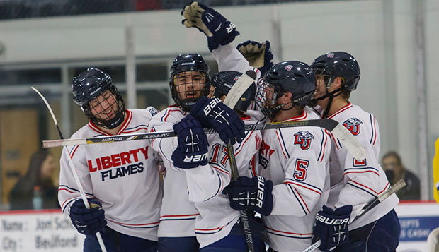 Liberty's fourth line celebrates the fourth goal by freshman defensman Bannon Lynott in the third period of Saturday's Southeast Region opener at the LaHaye Ice Center. test test test test