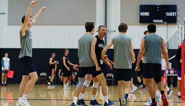 Flames freshman James Morton (left) celebrates with his Division II teammates in a Sept. 29 tournament at Liberty. (Photo by Joel Coleman) test test test test