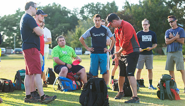 Flames Head Coach Steve Bowman (left) and graduate Devin Schwartz (sitting) listen to PDGA players Nathan Sexton (front) and Paul McBeth during last year's clinic held at Liberty. test test test test