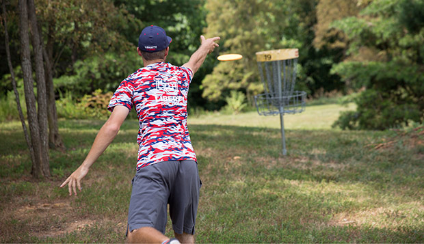 Liberty sophomore Jesse Miller follows through on a putt during the Virginia Commonwealth Games competition played in July on the Flames' East Campus course. (Photo by Kevin Manguiob) test test test test