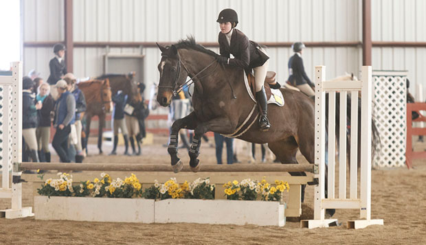 Freshman Elizabeth Chenelle landed the Lady Flames' second first-place finish of the season in the intermediate over-fences category Feb. 7 at Randolph College. test test test test