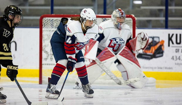 Freshman defenseman Kristi Serafin helps guard Liberty's goal during its matchup with the Washington Pride in the LaHaye Ice Center. (Photo by Andrew Snyder) test test test test