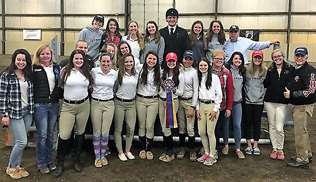 Members and coaches of Liberty's Hunter Seat equestrian team pose with Bob Cacchione, the IHSA's Executive Director, who was on hand to see the Flames clinch their first regional championship, Sunday in Fredericksburg.  test test test test