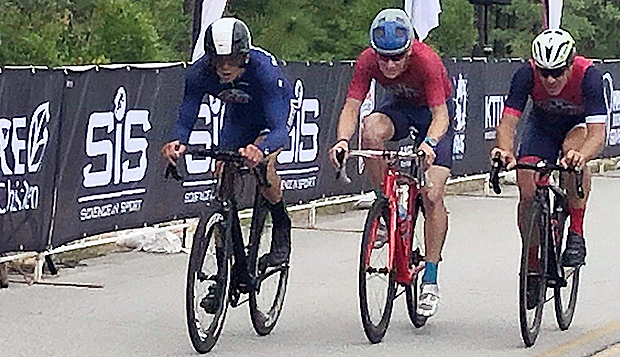 Freddie Shashaty (left) races in the Flames' team time trial at the USA Cycling Collegiate Road National Championships. test test test test