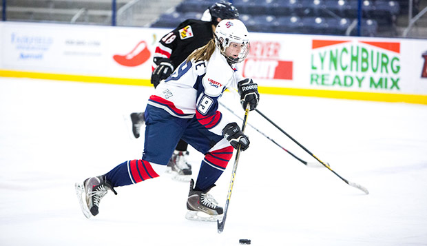 Lady Flames junior defenseman Grace LaPorte skates the puck up the LaHaye Ice Center in a Feb. 3 win over Maryland. (Photo by Andrew Snyder) test test test test