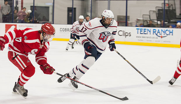 Flames sophomore center Grant Garvin skates by a Stony Brook defender in the first meeting, Nov. 14 at the LaHaye Ice Center.  test test test test