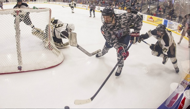 Liberty forward Grant Garvin works the puck behind Oakland's cage during last season's showdown with the Golden Grizzlies, on Military Appreciation night at the LaHaye Ice Center. test test test test