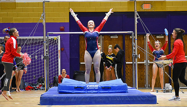 Lady Flames junior Mia Harvey lands her uneven bars dismount in a Feb. 29 meet at JMU. She and her gymnastics teammates earned a Club Sports record-high 3.92 GPA this spring. test test test test