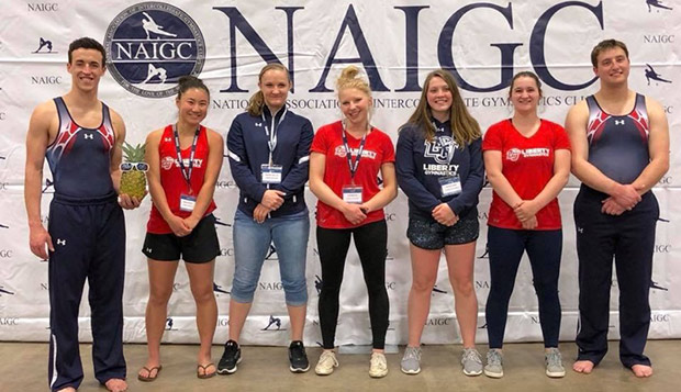 The five women, including Julie Bouton (center), and two male gymnasts who represented Liberty at the NAIGC championships in Fort Worth, Texas. test test test test