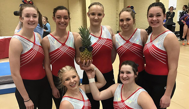 Liberty's gymnastics team celebrates its victory in the nine-team event Saturday at Clemson. (Submitted photo) test test test test