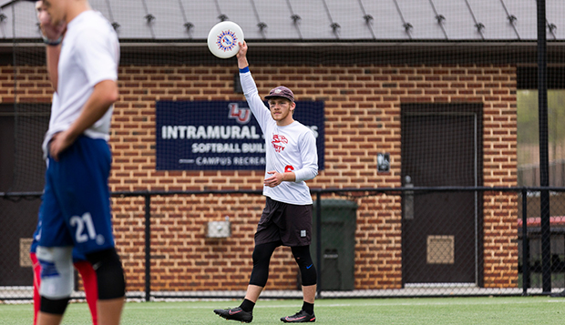 Senior captain Jake Norman prepares to huck the disc downfield to start a point at the Liberty Mountain Intramural Complex. test test test test