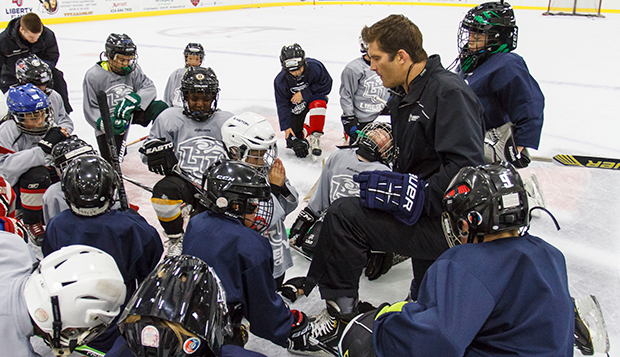 Liberty ACHA Division I men's hockey Associate Head Coach Jeff Boettger leads campers in prayer during a session at the LaHaye Ice Center. test test test test