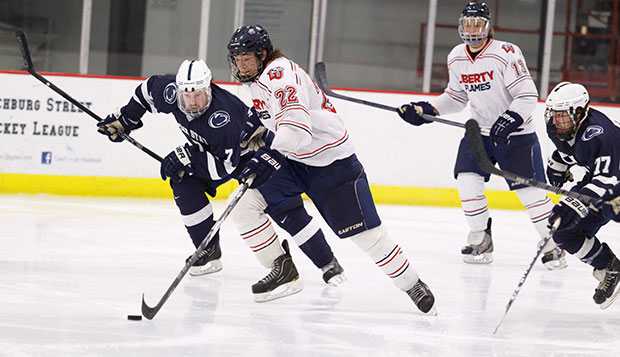 Sophomore forward Jeff Boschman (22) drew the Flames back within 4-3 with a goal late in the second period against the Nittany Lions, Friday night at the LaHaye Ice Center. test test test test