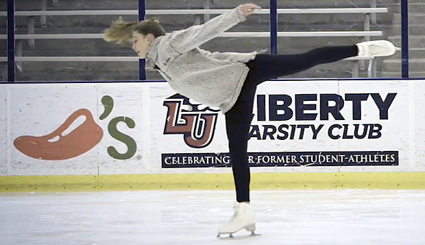 Jill Holste served as team captain for the Lady Flames figure skating team before graduating from Liberty in May. test test test test