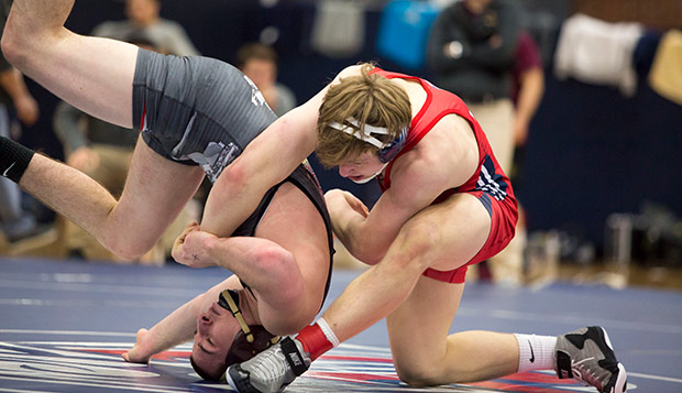 Liberty sophomore Joe Scott lost his 165-pound semifinal match on Friday and must wrestle through Saturday's consolation rounds to contend for third place. (Photo by Jessie Rogers) test test test test