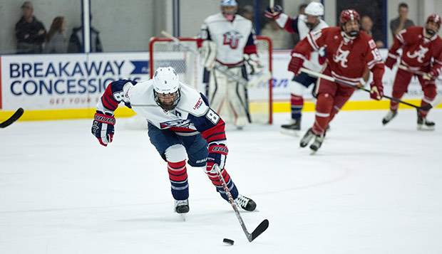 Sophomore forward and head captain Josh Hamilton chases after the puck in the Flames' Sept. 15 season-opening meeting with Alabama at LaHaye Ice Center. (Photo by Nathan Spencer) test test test test