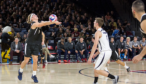Junior setter Kaden Knepper makes a dig during last year's 'Midnight Mayhem' match, a sweep of Virginia Tech in the Vines Center. (Photo by Nathan Spencer) test test test test