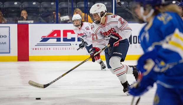 Liberty senior forward Kjrstin Hoberg starts a fast break in Friday's 3-2 loss to Delaware at the LaHaye Ice Center. (Photo by Caroline Cummings) test test test test