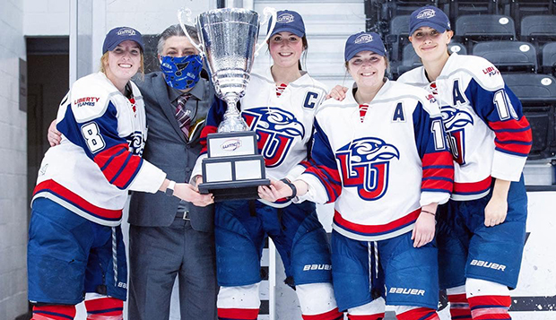 Lady Flames captains (from left) Vanessa DeMerchant, Shannon Fehr, Dana McLeod, and Danica Polson captured their second consecutive WMCH Tournament trophy. test test test test