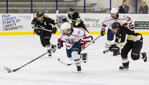 Liberty freshman Lauren McDonald starts a breakaway in a game last week against Colorado at the LaHaye Ice Center. test test test test