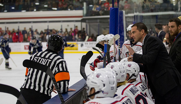 Liberty Head Coach Kirk Handy has a word with an official in last Friday night's game against Navy at the LaHaye Ice Center.  test test test test