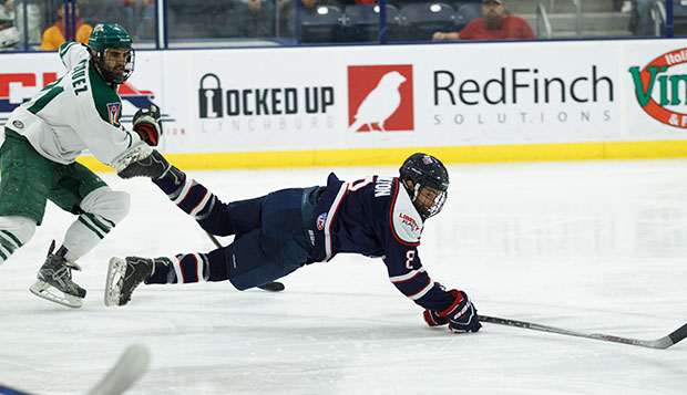 Flames freshman forward Josh Hamilton dives in an effort to get to the puck against Ohio. (Photo by Nathan Spencer) test test test test