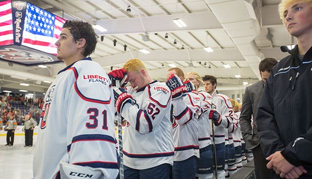 Members of Liberty's ACHA Division I men's hockey team stand for the National Anthem on Oct. 23, 2015, the night of the grand reopening of the renovated LaHaye Ice Center. test test test test