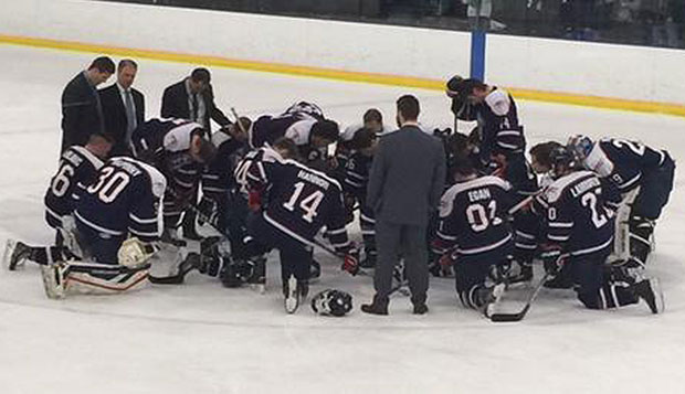 The Flames gather at center ice to pray after Saturday's 5-2 loss to the Bobcats at the OBM Arena in Strongsville, Ohio. test test test test