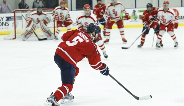 Liberty senior defenseman Ben Hughes and the Flames upset four-time defending champion Stony Brook in Sunday's ESCHL tournament championship game. (Photo by Nathan Spencer) test test test test