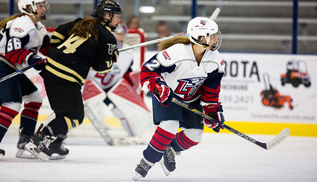 Lady Flames junior forward Lauren McDonald provided a spark on offense against the Washington Pride, Saturday at the LaHaye Ice Center. (Photo by Andrew Snyder) test test test test