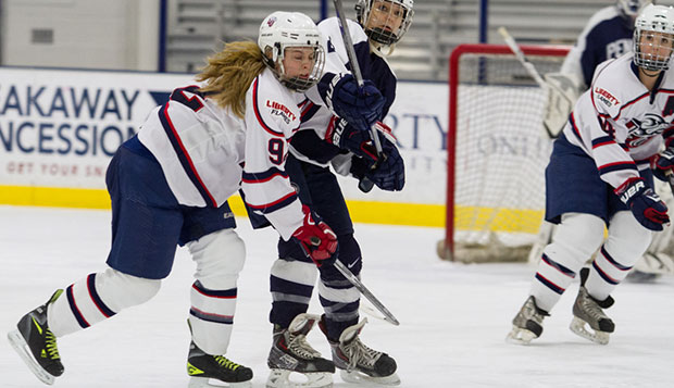 Liberty sophomore forward Courtney Gilmour collides with a defender in a recent contest at the LaHaye Ice Center. test test test test