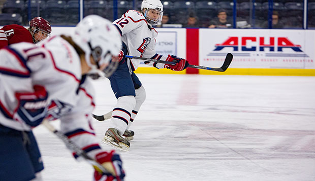 Lady Flames freshman forwards Mackenzie Carroll (12) and Aly Morris (10) work a fast break in a 3-1 win over UMass on Oct. 22 at the LaHaye Ice Center. (Photo by Caroline Cummings) test test test test