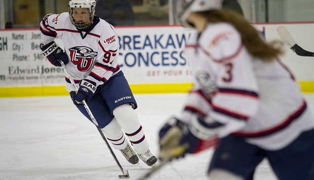 Liberty sophomore defenseman Sarah Fowler starts a transition beside sophomore forward Carrie Jickling in the Lady Flames' 4-2 loss to No. 1 Miami of Ohio, Thursday at the LaHaye Ice Center. test test test test