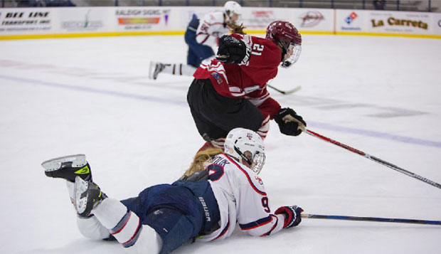 Liberty senior forward Courtney Gilmour slides to slow down UMass forward Katy Turner's rush at the LaHaye Ice Center. test test test test