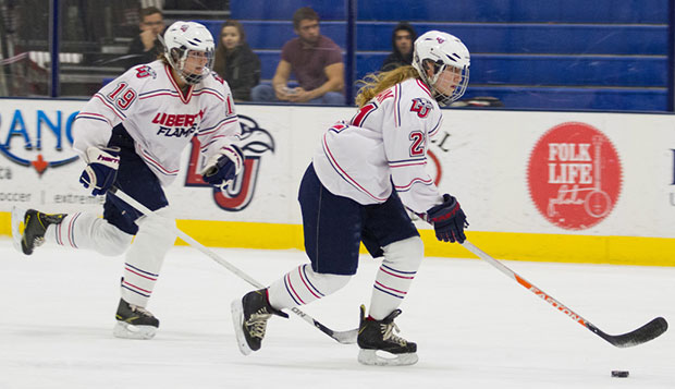 Senior defenseman Megan Shellman leads the attack in a home loss to Connecticut on Jan. 31 as senior forward Alëna Steiger trails on the play. test test test test