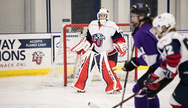 Lady Flames goalie Kelly Hutton defends against Bishop's University at the LaHaye Ice Center. (Photo by Leah Stauffer) test test test test
