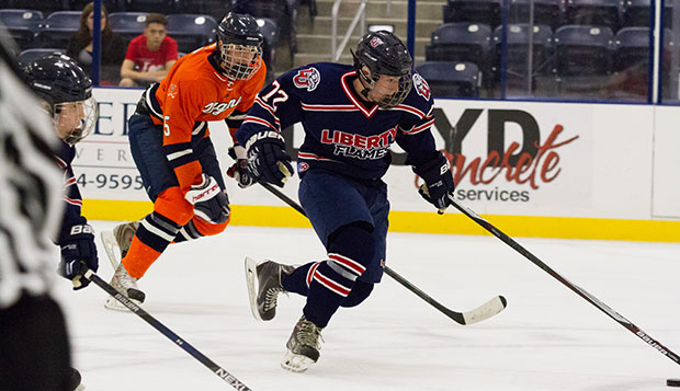 Freshman forward Kyle Jassman leads a Liberty fast break in an 8-4 loss to Virginia on Nov. 6 at the LaHaye Ice Center. test test test test
