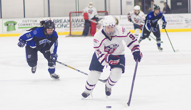 Freshman forward CJ Tipping is set to score the Lady Flames' second goal on a breakaway late in the first period of Friday's 3-2 win over Grand Valley State at the LaHaye Ice Center. test test test test