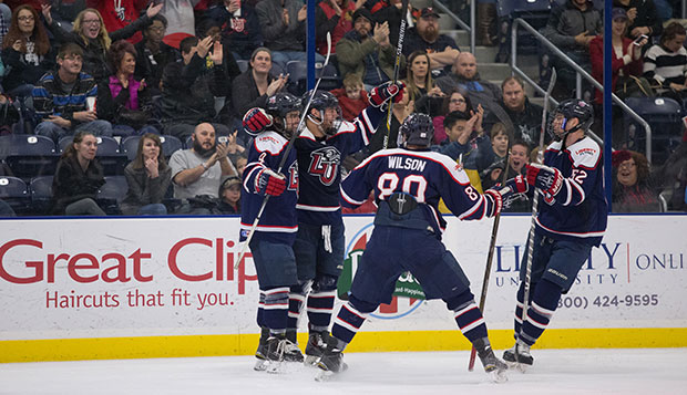 Members of Liberty's ACHA DI men's hockey team celebrate a goal against Minot State, Feb. 19 in the LaHaye Ice Center.  test test test test